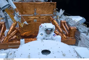 Astronaut Mike Massimino works with the Hubble Space Telescope in the cargo bay of the Earth-orbiting space shuttle Atlantis. Photo Credit: NASA. May 15, 2009.